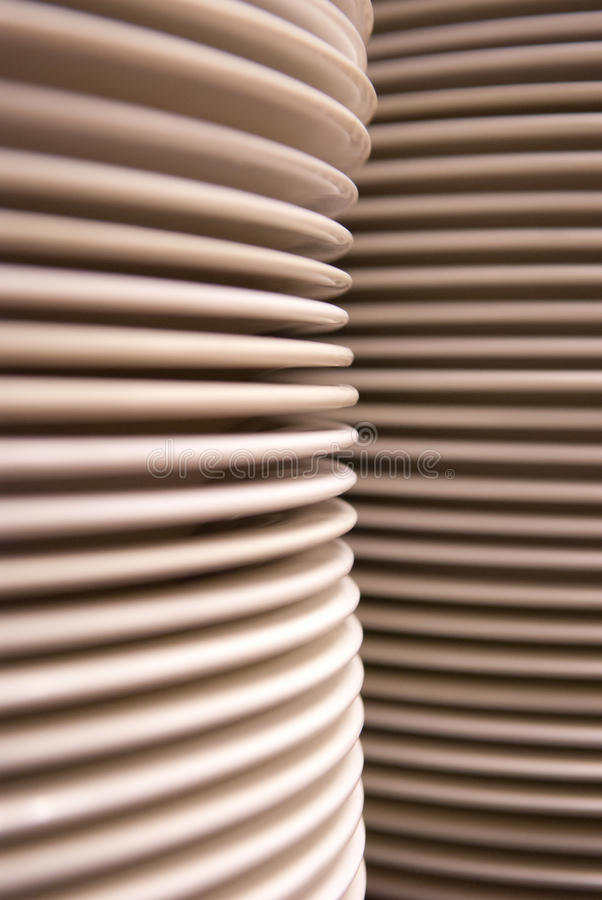 Stacks of white plates royalty free stock images