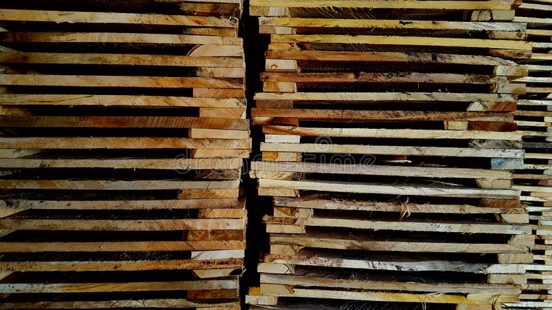 Stacks of wooden pallets, neatly lined up ready to use. For various box stock photography