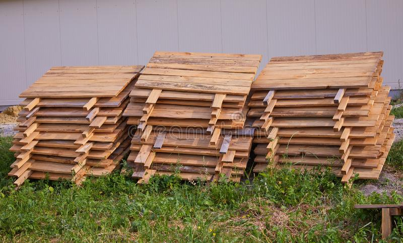 Stacks of wooden snail boards for Edible snails royalty free stock photography