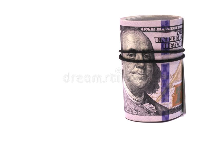 Staczający się w tubkę sto dolarów banknotów obrazy royalty free