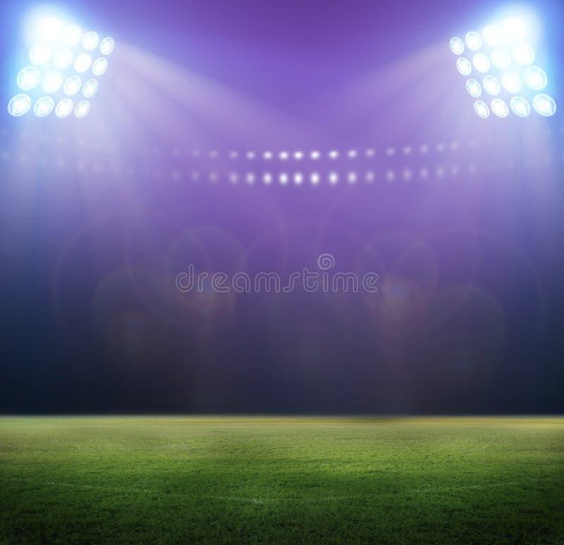Stade dans les lumières photos stock