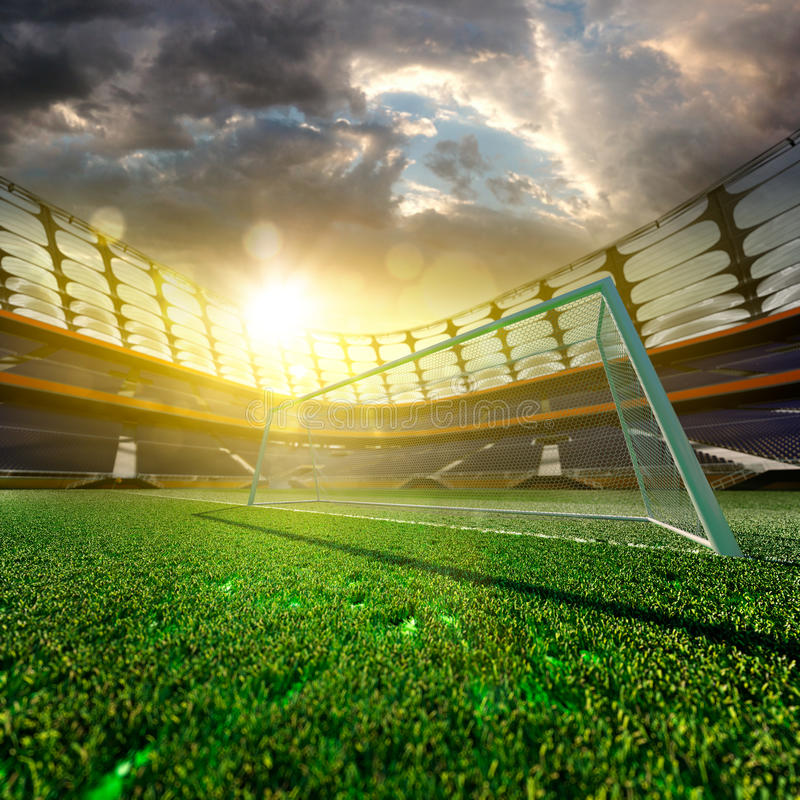 Stade de football vide au soleil photo stock