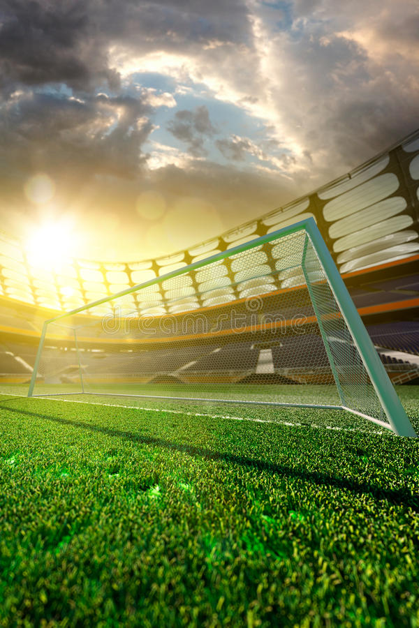 Stade de football vide au soleil photo libre de droits