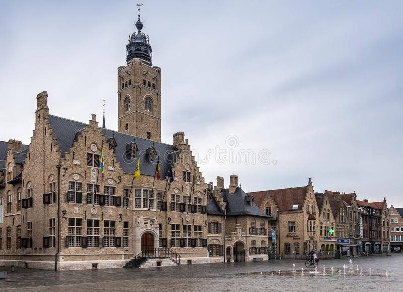 Stadhuis or City Hall of Diksmuide, Flanders, Belgium. Diksmuide, Flanders, Belgium -  June 19, 2019: Grote Markt. Wider shot of Brown brick historic City Hall royalty free stock images