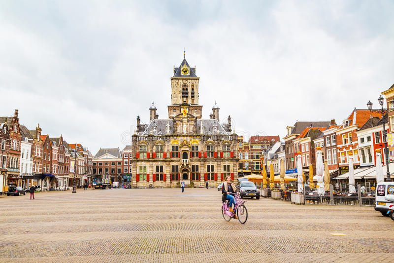 Stadhuis or City Hall, Markt square, houses, people in Delft, Holland royalty free stock photos