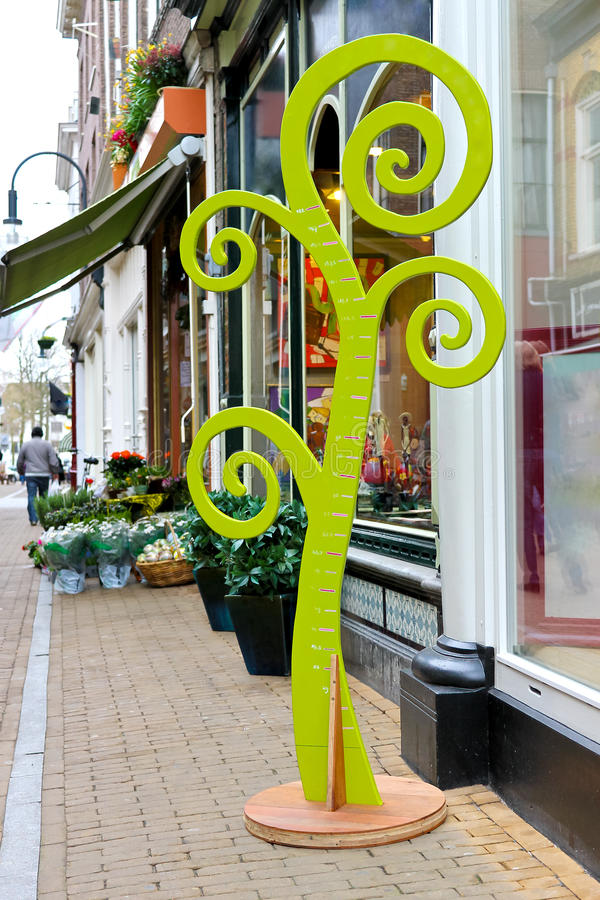 Download Stadiometer - Tree Near  Store Flower Stock Image - Image of color, gorinchem: 25509827