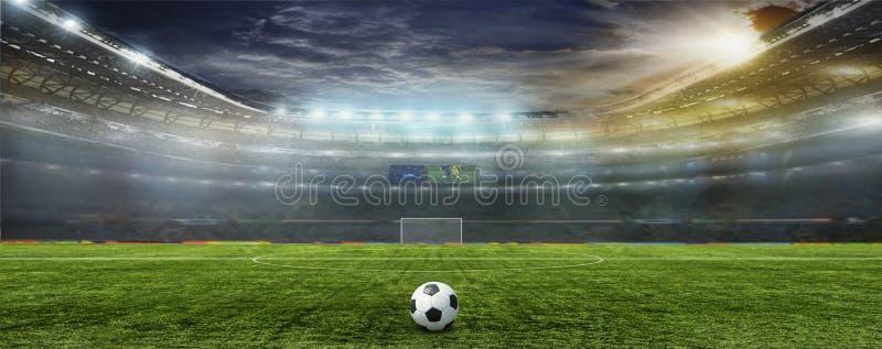 Stadion med fans natten för matchen royaltyfri fotografi