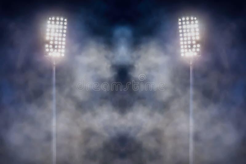 Stadionslichter und -rauch stockfotografie