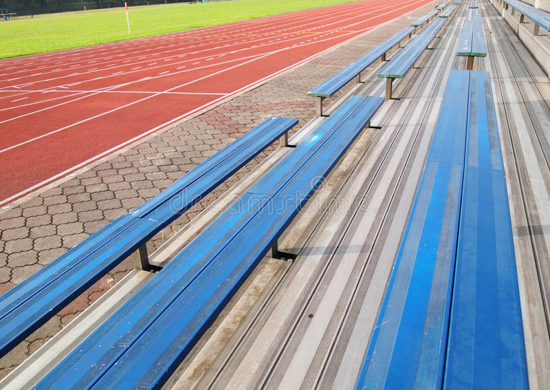 Stadium field and empty seats royalty free stock images