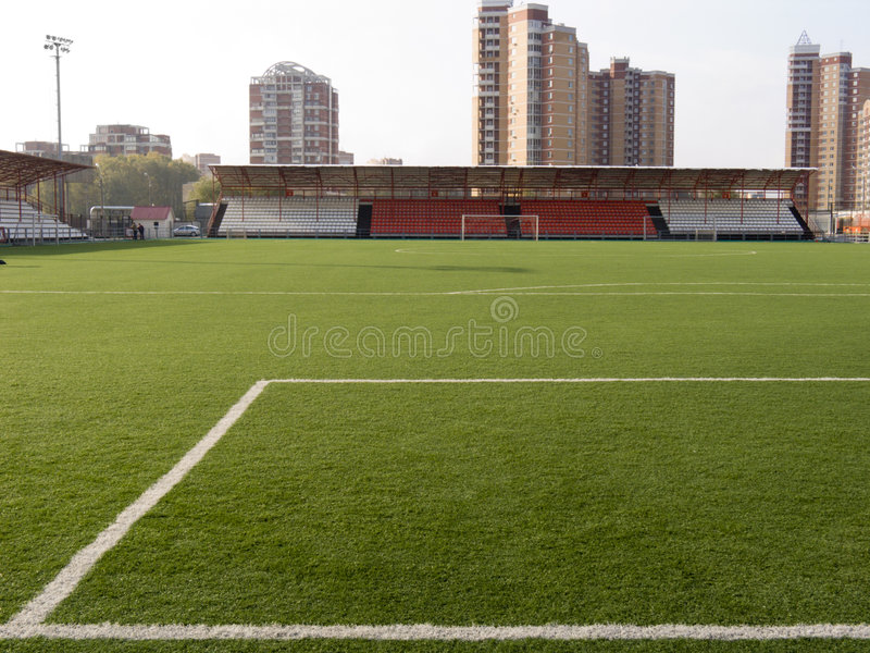 Stadium with a field for soccer. In city stock photos