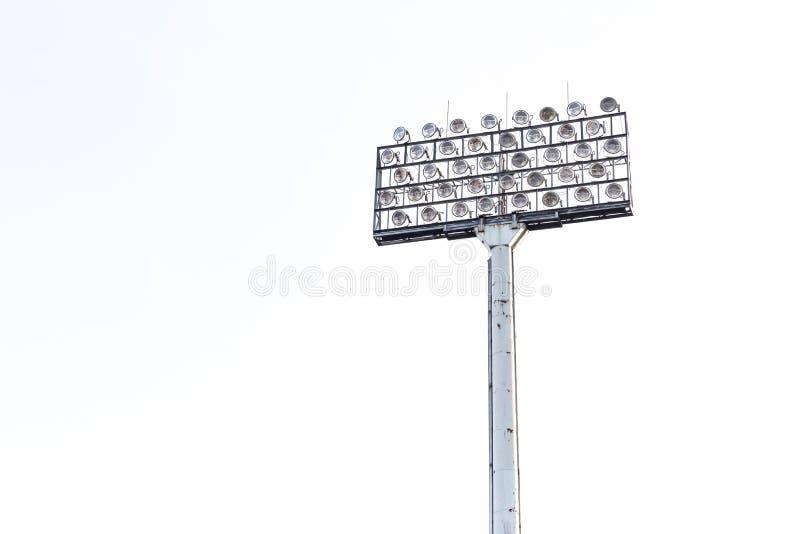 Stadium floodlight na białym nieba tle fotografia royalty free