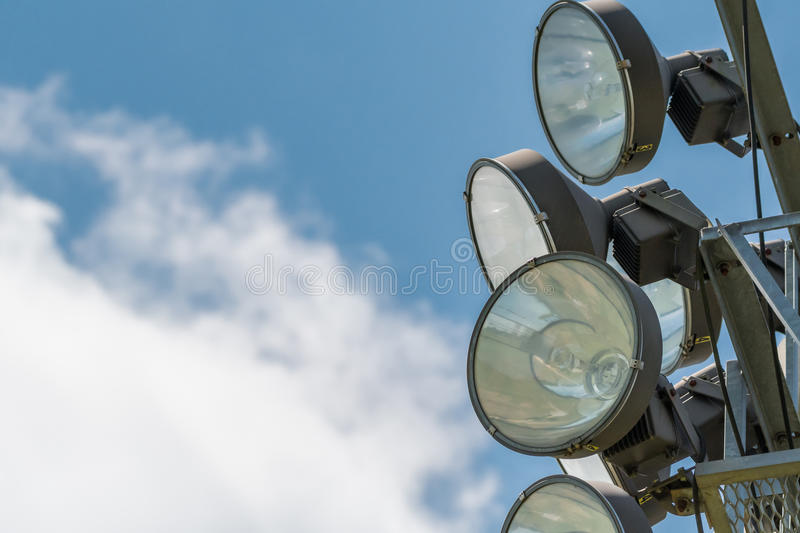 Stadium Lights on Cloudy Blue Sky. With copy space stock photography