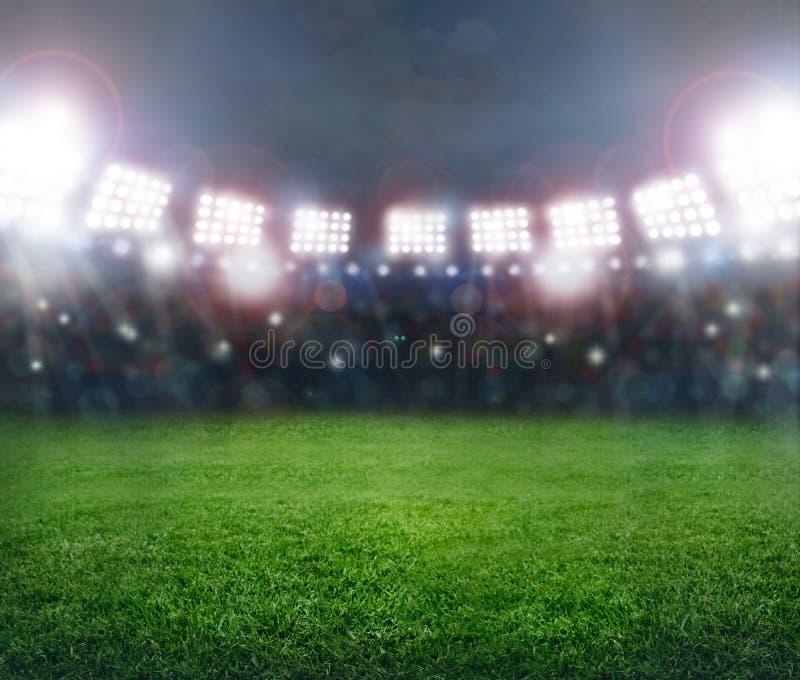 Stadium in lights. Green soccer stadium, illuminated field, arena in night royalty free stock photos