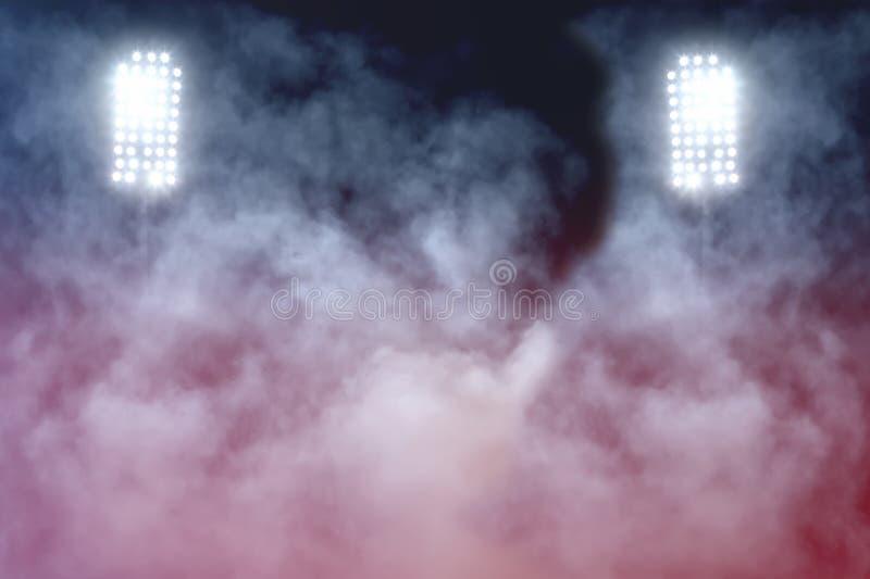 Stadium lights and smoke royalty free stock photography