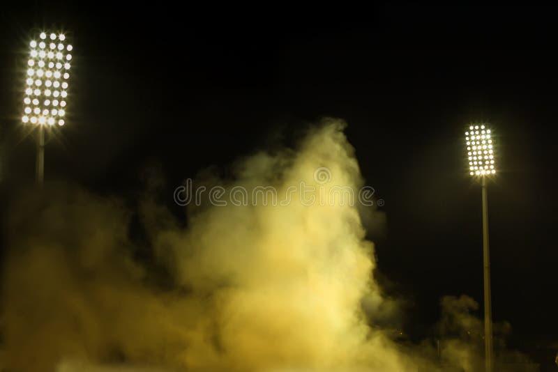 Stadium lights and smoke royalty free stock photos