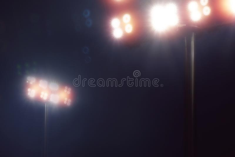 Stadium lights in sport game in dark night sky royalty free stock photo