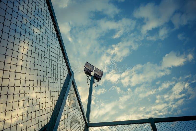 Stadium lights under blue sky with pastel tone royalty free stock photos