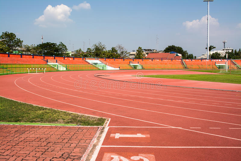 Stadium for outdoor sports. A stadium is a place for outdoor sports consists of a field or stage either partly or completely surrounded by a tiered structure stock photography