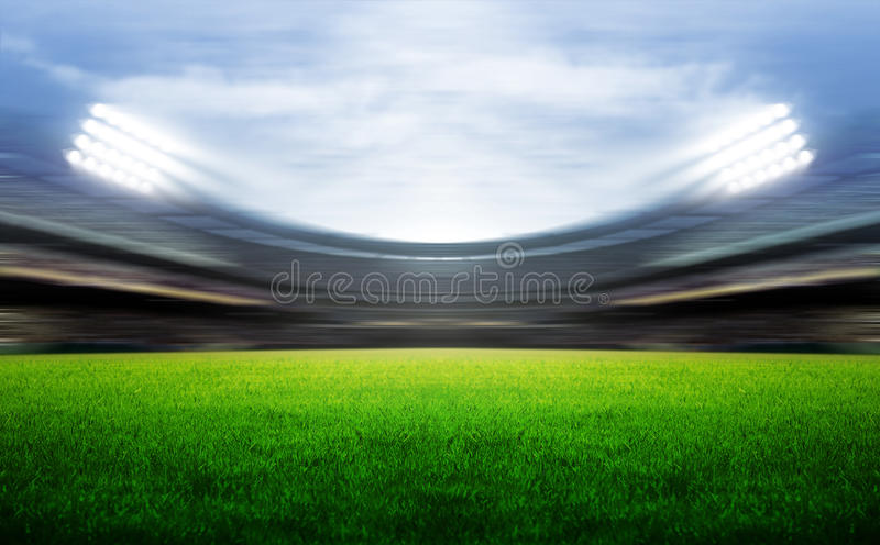Stadium. Soccer stadium with spotlights and green grasses royalty free stock image