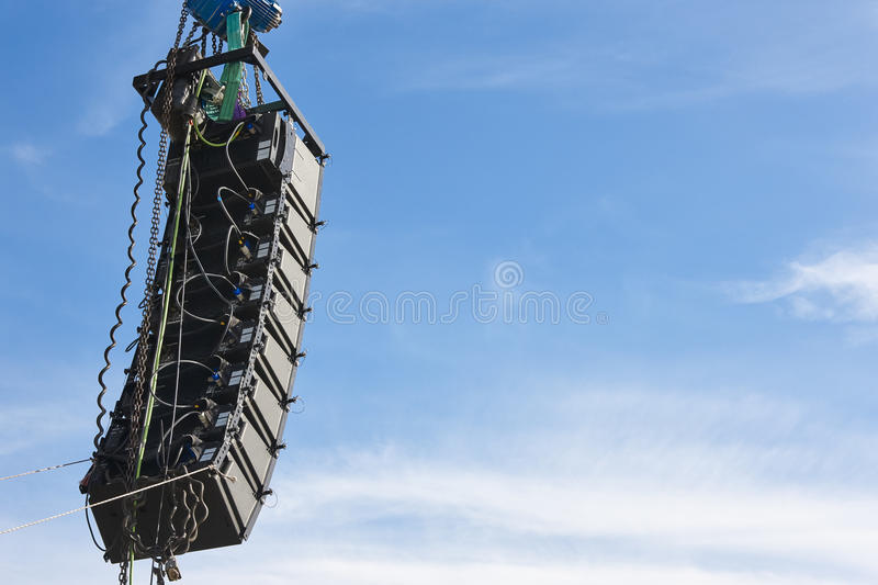 Stadium speakers rack over a blue sky. Live music background stock image