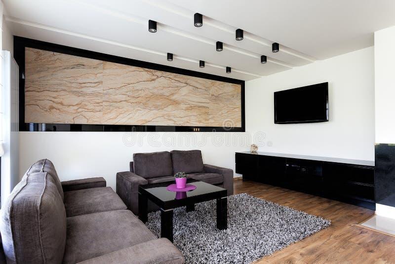 Stads- lägenhet - modern vardagsrum arkivfoto