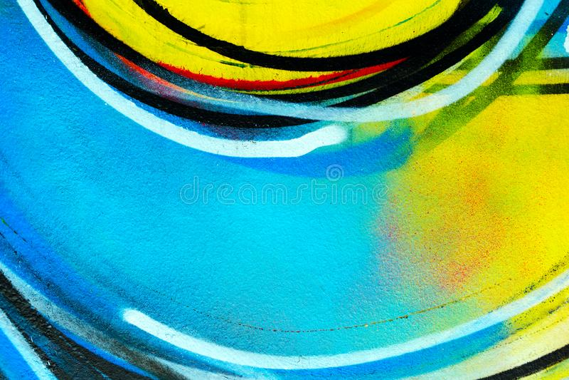 Stads- vägg - färgrik bakgrund Grafitticloseup arkivfoto
