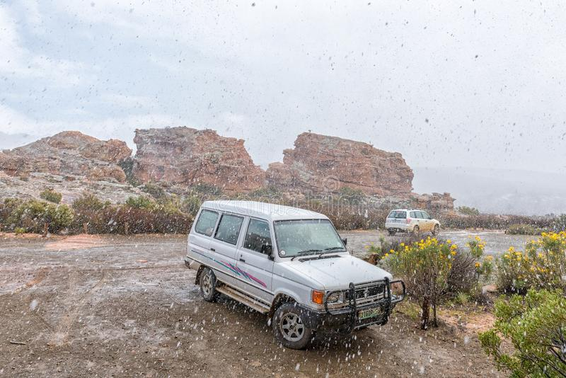 Snow is falling at the parking area at Stadsaal Caves stock images