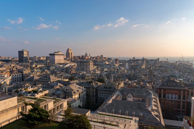 Stadslandskap av Genoa Italy At Sunset With blå himmel royaltyfri bild