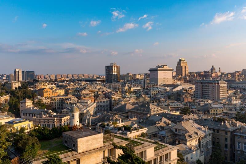 Stadslandskap av Genoa Italy At Sunset With blå himmel royaltyfria bilder