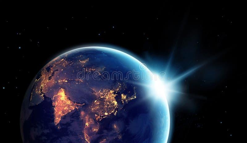 Stadslichten bij nacht in aarde met met zon het toenemen royalty-vrije stock foto's