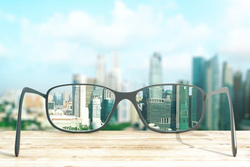 Stadtbild fokussiert in den Glaslinsen lizenzfreie abbildung
