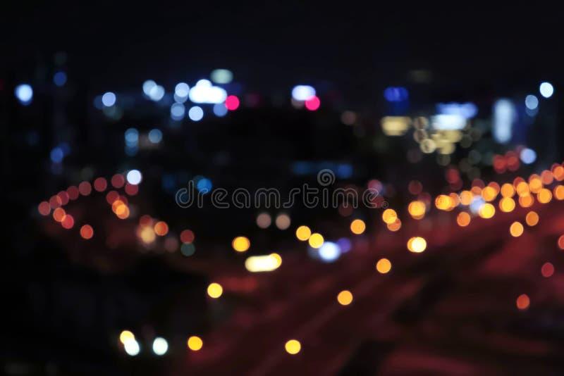 Stadtlicht Nachtstadtlichtlebenverkehr Unscharfes Bremslicht Weinlesenachtstadtlicht Städtische Stadtbildzusammenfassung stockbilder
