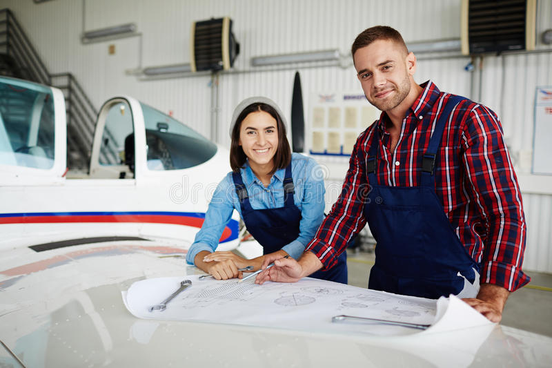 Staff of airplane repair service royalty free stock photography