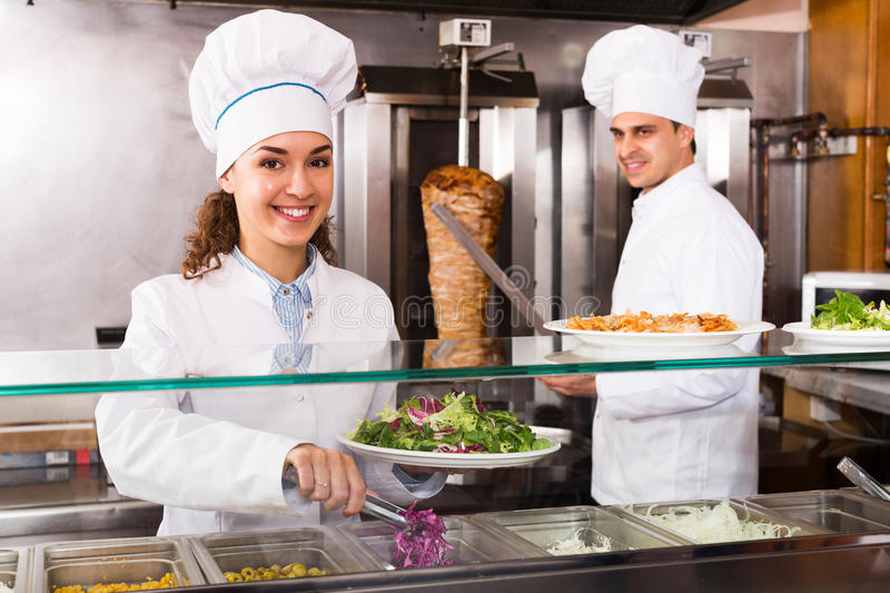 Staff posing at kebab counter royalty free stock photos