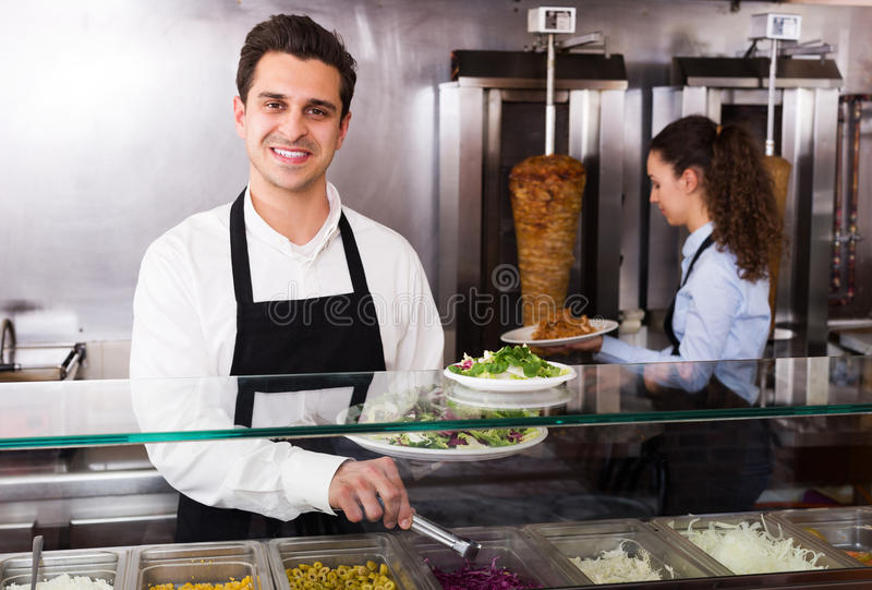 Staff posing at kebab counter royalty free stock image