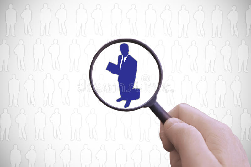 Staff selection symbol, looking for a businessman among the candidates. Empty copy space for Editor`s text stock image
