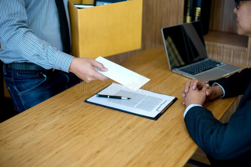 Staff send white envelop to boss dismissed. Worker quit out from company royalty free stock image