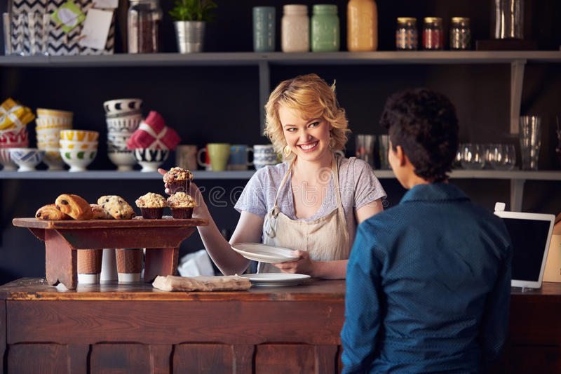 Staff Serving Customer In Busy Coffee Shop royalty free stock images