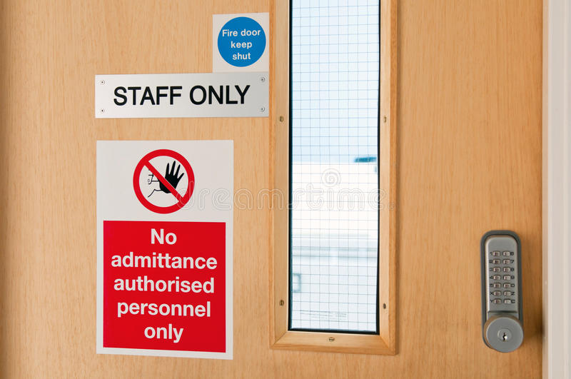 Staff only signs at laboratory