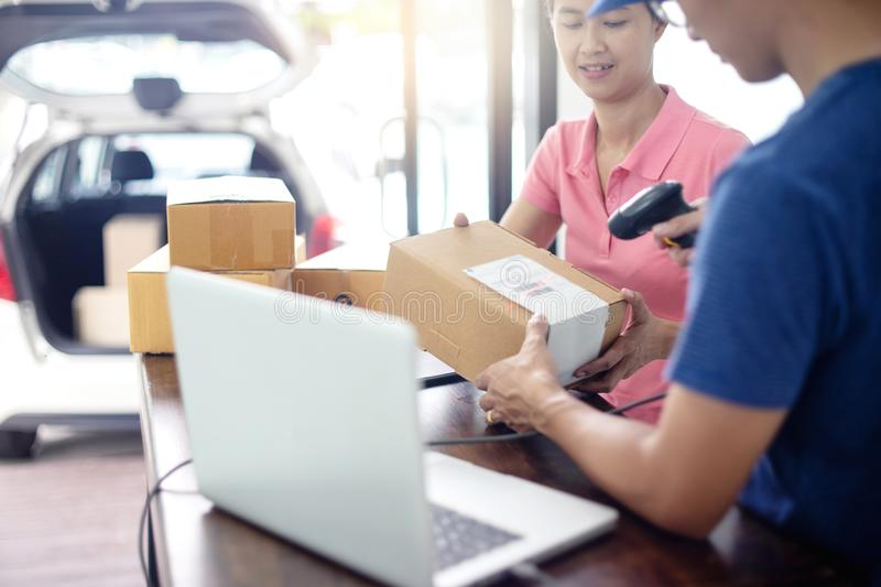 Staff work together delivery the box royalty free stock images