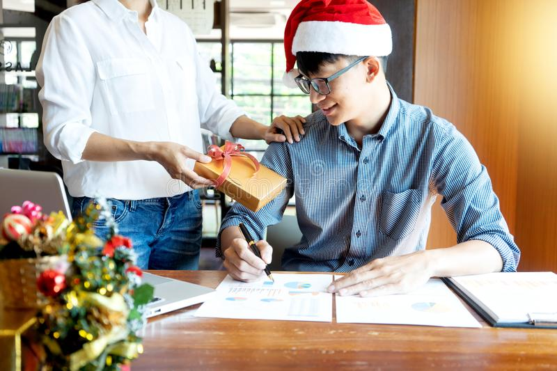 Staff working in office near chrismas season royalty free stock images