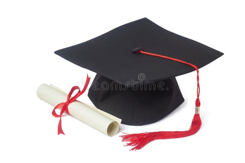 Staffelungschutzkappe und -diplom stockbild