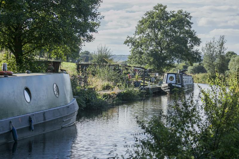 Staffordshire; British countryside on a sunny day; barges ona a canal. Staffordshire is a landlocked county in the West Midlands of England. It borders with stock photo