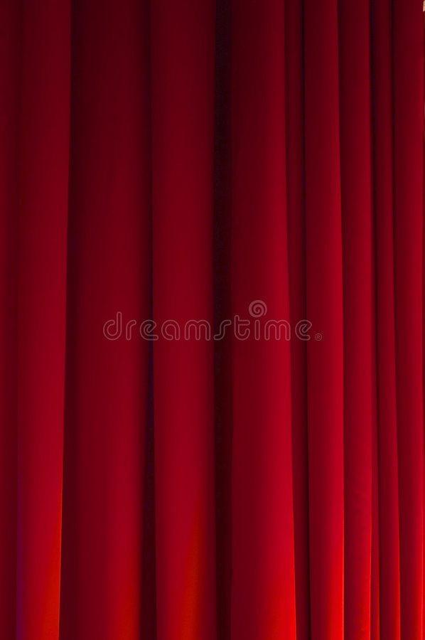 Stage curtain. Red stage curtain, ideal as a background for a performing-arts related theme/live show advertisement. Vertical composition royalty free stock photography