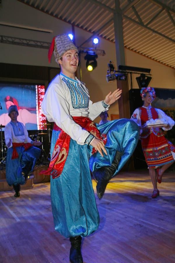 оn stage are dancers and singers, actors, chorus members, dancers of corps de ballet, soloists of the Ukrainian Cossack ensemble stock image