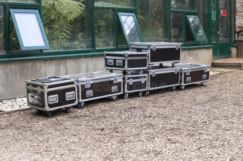 Stage equipment packed in special cases. package backstage concert lighting scenery sound equipment for performance. Transportation of stage equipment stock images
