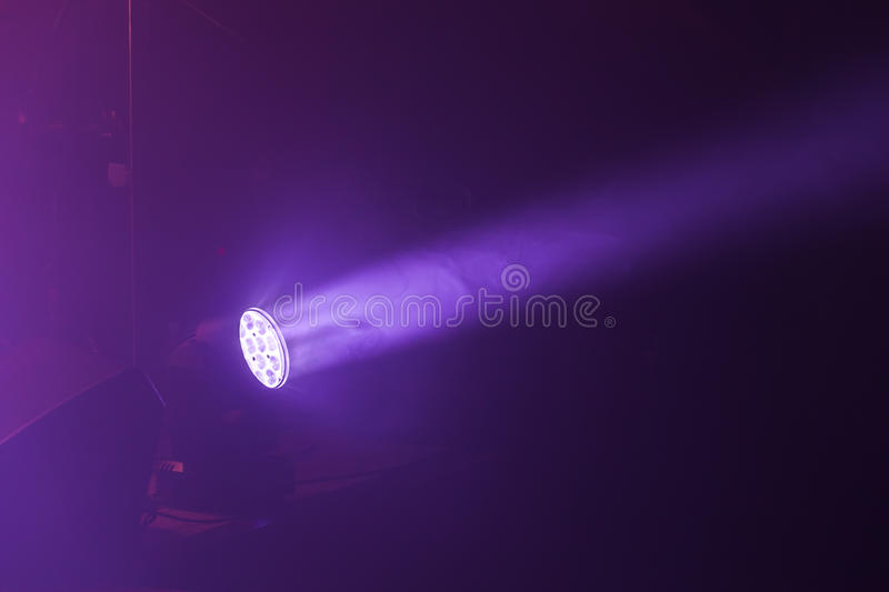 Stage LED spot light with purple beam. Stage illumination equipment stock images