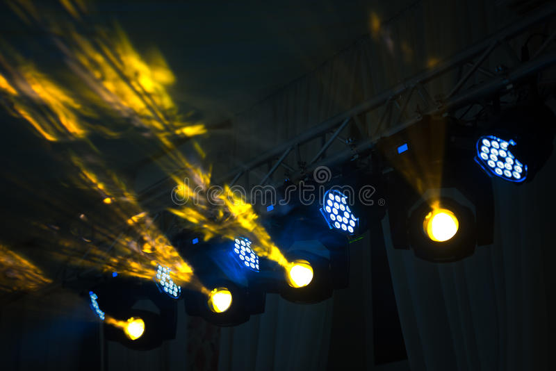 Stage lighting rig with moving heads royalty free stock photos