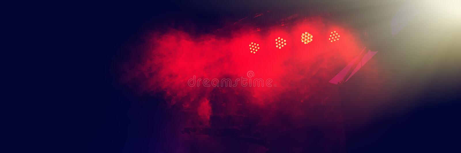Stage lighting at a rock band`s night concert. Web banner stock photos