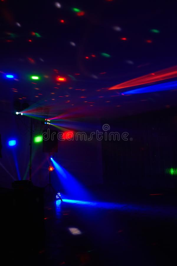 Stage lights in action at the concert. Lights show. Lazer show. Night club dj party people enjoy of music dancing sound with colorful light. club night light royalty free stock image